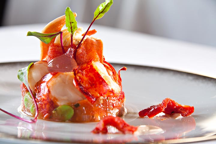 Lobster served warm with a light dressing of rhubarb, tomato and ginger