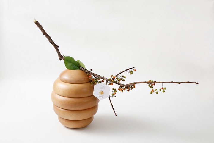 A buzzing beehive opens to reveal petit fours inspired by bees and honey