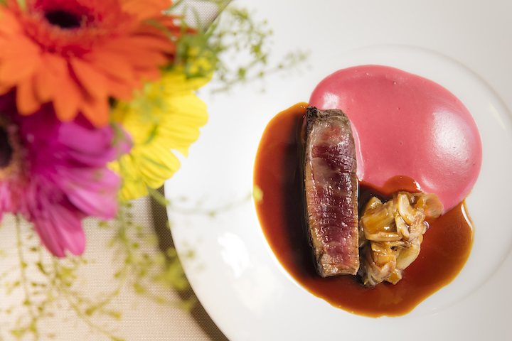 Wagyu Tenderloin with Candied Chicory, Creamy Beet and Potatoes Souffle Bigarade Sauce