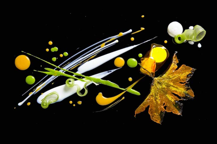 Dish of Dungeness crab, squash blossom, cardamom and saffron from Alinea